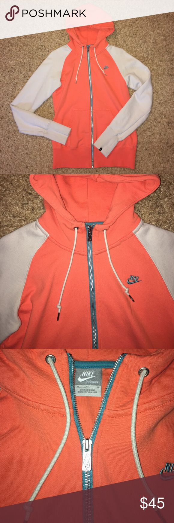 Color block Nike zip up hoodie Orange/coral with cream sleeves. Blue and silver zipper . Thick neck. Towel material on inside. NEVER WORN! Nike Tops Sweatshirts & Hoodies
