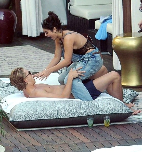 Vanessa Hudgens and Austin Butler Photos Photos - Actress Vanessa Hudgens and her boyfriend Austin Butler seen sharing a kiss while laying out poolside in Miami, FL. The couple seemed very much in love as they hung out with friends and had some drinks. - Vanessa Hudgens And Austin Butler Making Out In Miami