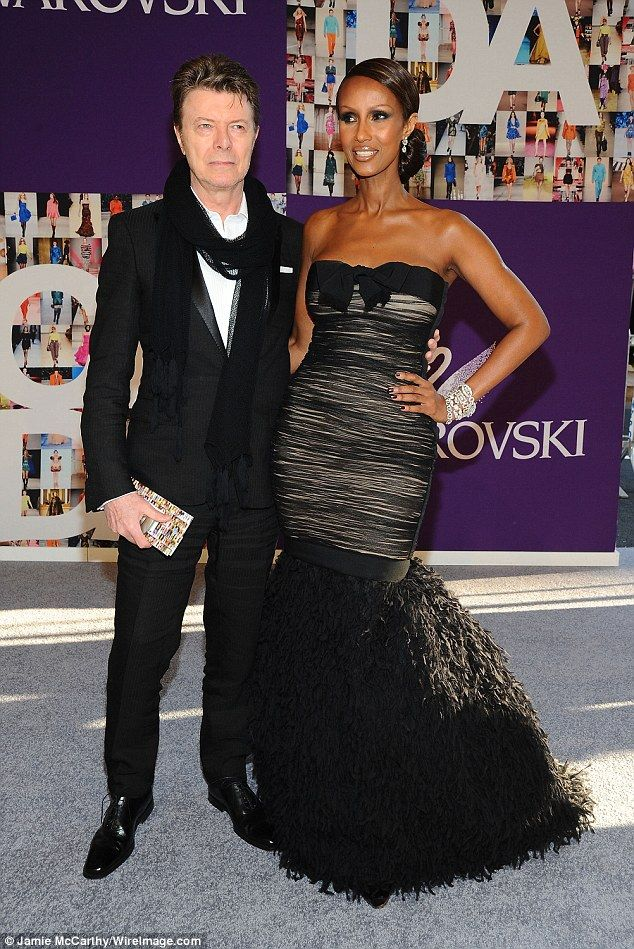 Iman - Loved up: The former runway model tied the knot with David Bowie in 1992; here the couple are pictured in 2010 in New York