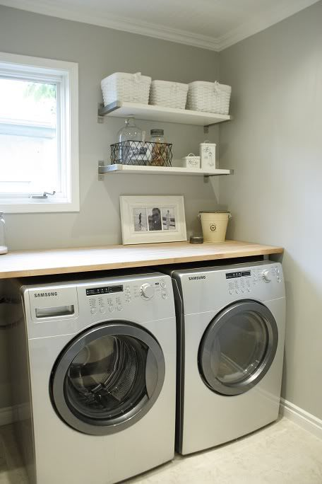 laundry room shelves . I could build a corner shelf over the drier, baskets folding.