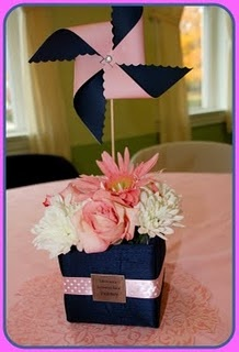 This is the EXACT centerpieces we did for Kynzlee's first birthday! They were pink and orange though!!