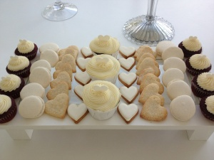 Birdcage Tea Bar -Red velvet cupcakes with cream cheese frosting, iced vanilla biscuits, vanilla macaroons and meringues.
