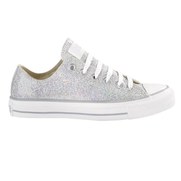 Converse Silver glitter low rise shoes All Star Converse silver glitter low rise. Worn 15+ times, no longer pure white on the base. Size 9 in women's. Size 7 in men's. Converse Shoes Sneakers