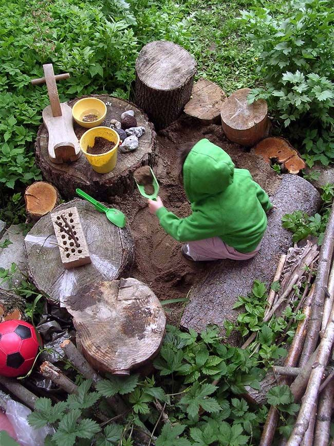 natural playspace with tree stumps and branches