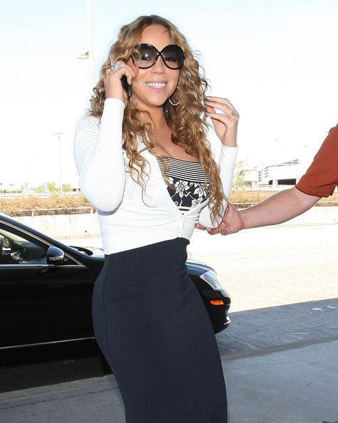 Mariah Carey Photos - Singer Mariah Carey departing on a flight at LAX airport in Los Angeles, California on September 8, 2012. - Mariah Carey Departing On A Flight At LAX