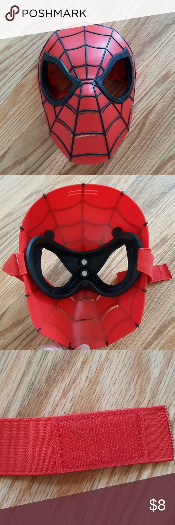 """Spiderman Mask Very good condition Spiderman mask. About 8.5"""" long.   Made of plastic that also has some flexibility to it. Perfect for Halloween and play! Costumes"""