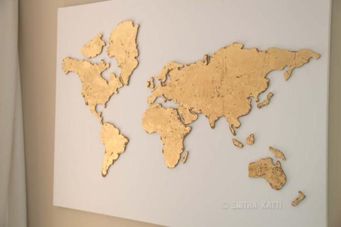 GoldLeaf on cork world map parts mounted to canvas