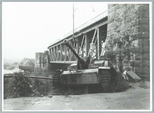 A bridge too far. Tank near a bridge destroyed in the battle of Arnhem. Near Driel-Oosterbeek. Nederland, Sept. 6, 1945.