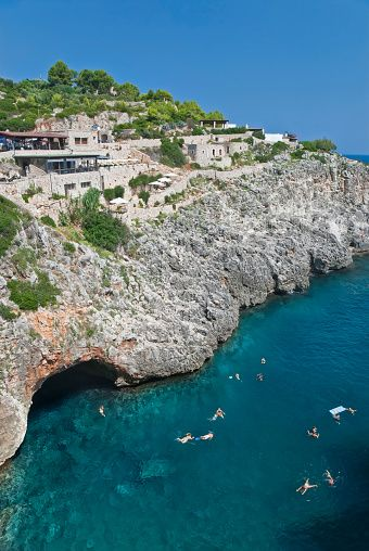 People enjoy the sea in Ciolo Fjord. Santa Maria Di Leuca. Apulia. Italy. Europe