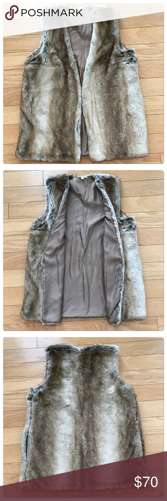 NWT, Stunning Gianni Bini, Faux Fur Neutral Vest! NWT, Stunning Gianni Bini, Faux Fur Vest! Beautifully designed with neutral tones of brown, tan with a grey undertone. Fully lined with hidden side pockets! Hidden front optional hook & eye closure. Shell: 79% acrylic & 21% polyester. Lining 100% polyester. Size XS but can fit sizes XS-M. 🚫No Trades Gianni Bini Jackets & Coats Vests