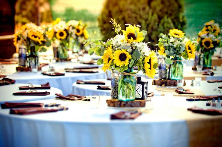 True Country Wedding: tables and centerpieces - not thinking I want sunflowers but these are gorgeous!