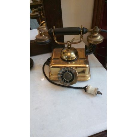 This is an antique danish telefon telephone from the early 1900's. It is a kjobenhavn telefon aktieselskab rotary telephone it has a metal gold plated 24k base with a rotary dial that turns smoothly. It has a cradled receiver with a removable  plastic bakelite mouth piece.