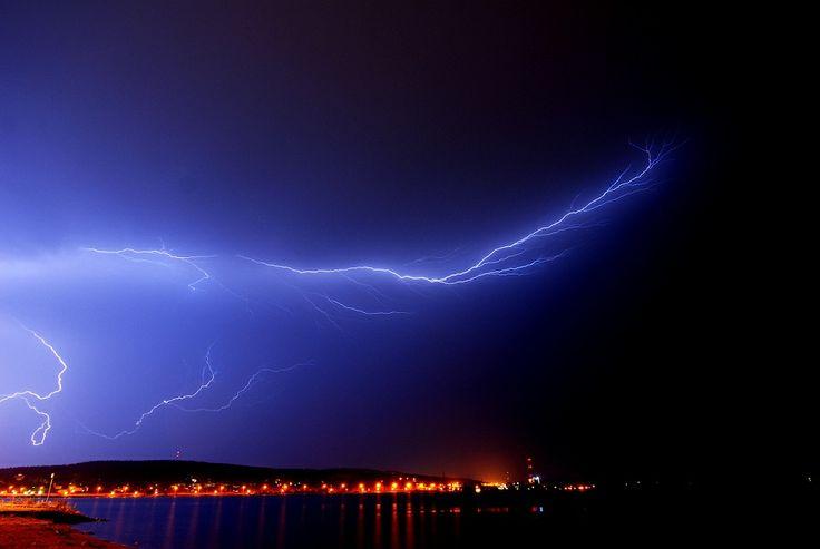 Flash. This is my friend Eero Karvinen daring picture.  #flash #harbor #nature #sky #phenomena #lightphenomena