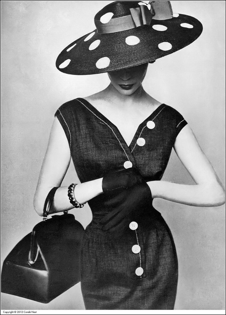 Jean in charcoal gray Moygashel linen sheath with white buttons by Larry Aldrich, black straw cartwheel painted with white dots and red ribbon by Tatiana, Rosenstein bag, photo by Irving Penn, Vogue, April 1, 1954