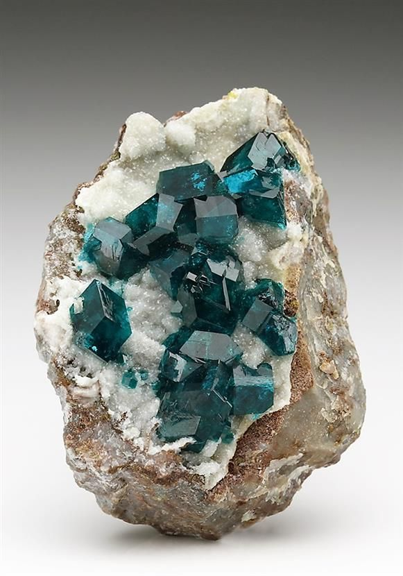 An excellent Dioptase specimen from the Tsumeb Mine. Crystal Classics Minerals