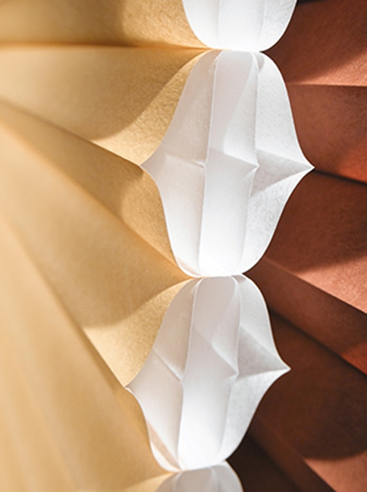 A honeycomb-within-a honeycomb.  More layers + more cells = more energy efficiency.  Duette® Architella® honeycomb shades