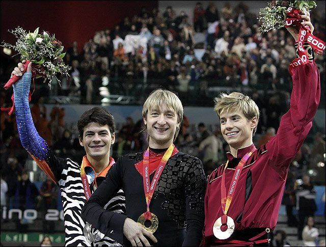 Evgeni Plushenko (RUS), Stephane Lambiel (SUI), and Jeffrey Buttle (CAN) 2006 Torino