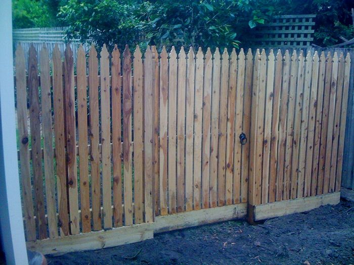 Vertical windsor picket side feature fence with pedestrian gates. Styles of fences