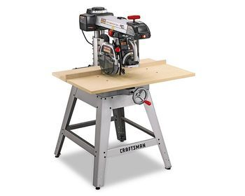 If your radial arm saw's table is damaged, what type of sheet material should you use to replace the table? Is plywood really the best choice?