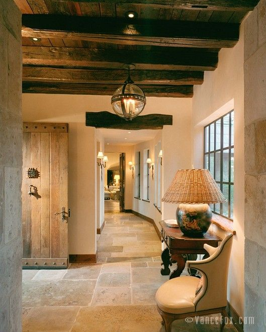 I am pretty obsessed with beams.  Add some sconces and rustic wood doors...just beautiful