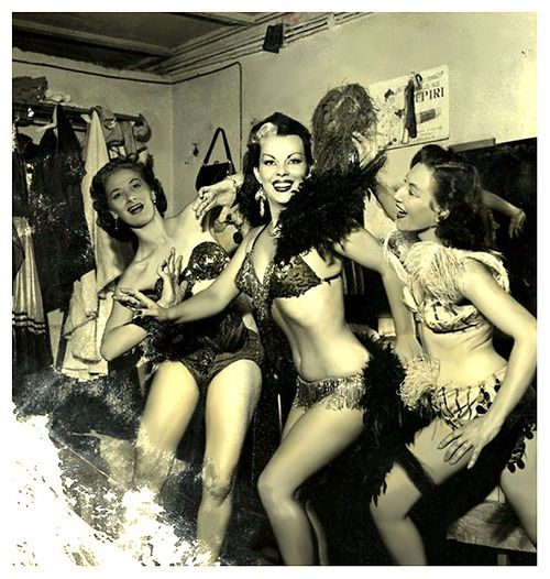 50's-era photograph captures burlesquer Tongolele posing with a pair of fellow showgirls, in the dressing room of an unidentified nightclub.