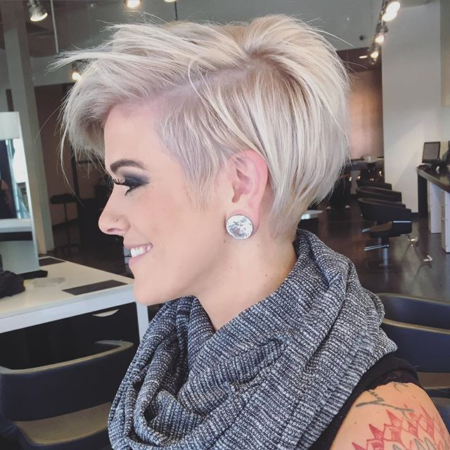 Short asymmetrical blonde cut.