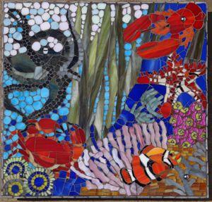 Ocean scene glass mosaic plaque on fibre cement board. R1100.00