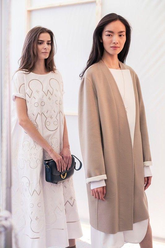 Camel coat and t-shirt dress backstage at Hermès SS15 PFW. More images here: http://www.dazeddigital.com/fashion/article/22040/1/hermes-ss15