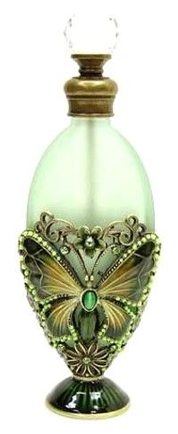 Antique perfume bottle (green, butterfly). I would to be the genie in this magic bottle.