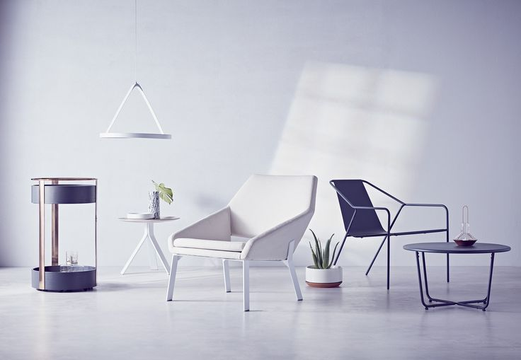 Modern by Dwell Magazine is a holistic home collection, available exclusively through Target starting December 27. Pictured above from left to right: the Bar Trolley in black/copper, $149.99; LED Pendant Light in white, $99.99; Side Table in white/natural, $89.99; Lounge Chair in white/natural, $249.99; Outdoor Lounge Chair in gray, $269.99 for two; Outdoor Side Table in gray, $89.99.