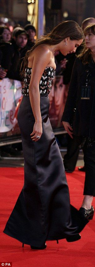 Flash of leg: A split at the back of Alicia's dress showed off her pins and towering platf...
