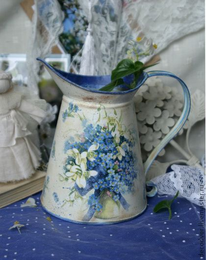 `Primroses` jug. Vase-jug with delicate spring flowers made ​​in the technique of decoupage with aging. On both sides of the pitcher has a floral motifs. Coated with a protective varnish, the bottom is also processed with acrylic paint and coated with acrylic lacquer