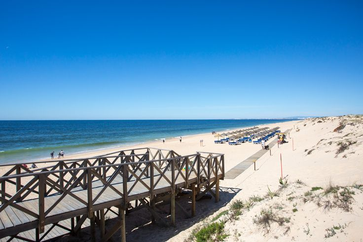 Known as the 'jewel in the Algarve's crown', is the Quinto do Lago beach. Over three kilometres of white sandy beaches are accessible via a pretty wooden bridge over the tidal lagoon. The sand dune backdrop makes this beach picture perfect and with its crystal clear water, it's no wonder it's been awarded Blue Flag status.