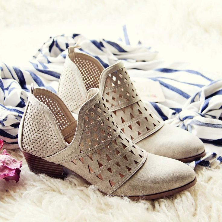 Spool Finn Booties. Designed with a stacked heel, laser cut details, and a soft brushed stone base. #boots #ankleboots