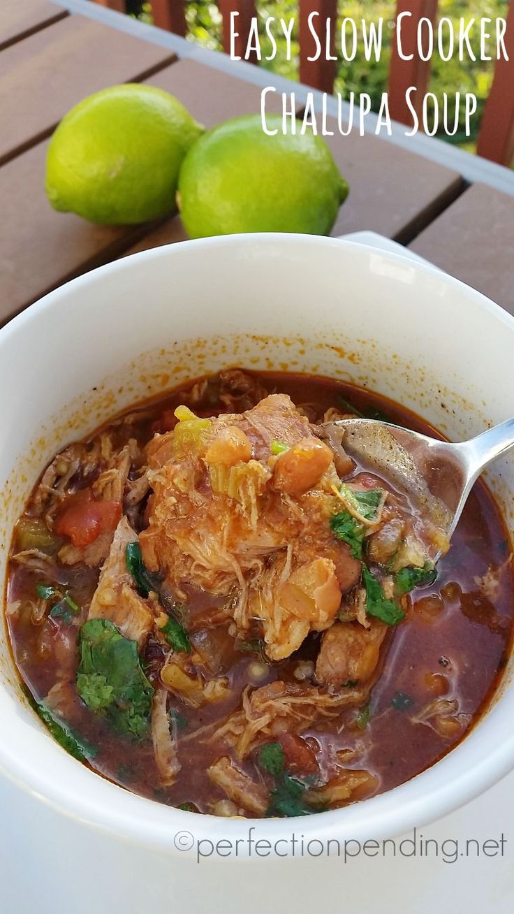 Easy Slow Cooker Chalupa Soup. The perfect crockpot recipe for a cilantro lime flavored pork soup! SO easy too!