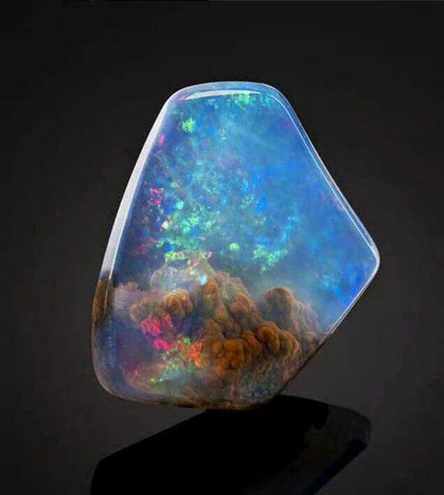 This gorgeous opal looks like it has a nebula inside it