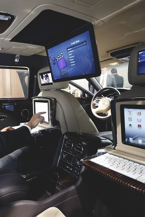 Inside a Bentley! Loving the idea of ipads on the back of the seats!!