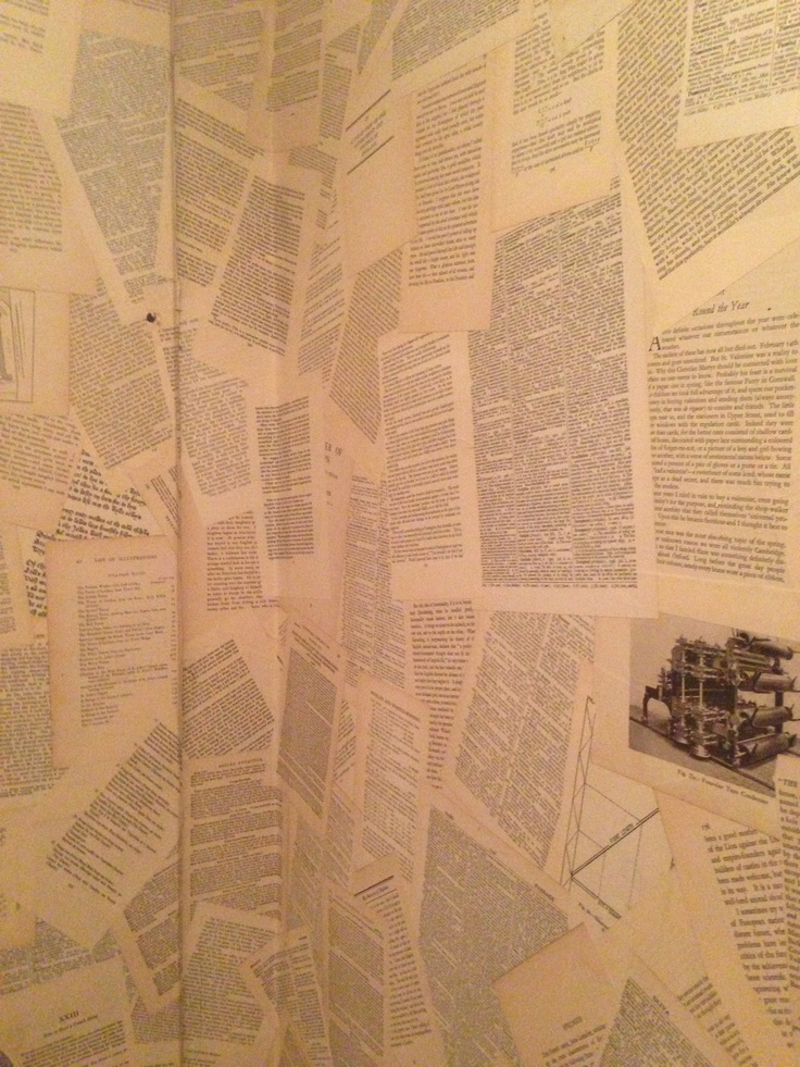 I covered my wall with an 80 year old webster s dictionary for Book wallpaper for walls