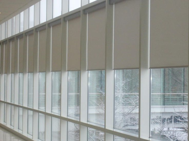 Electric curtains add elegance to any office space.