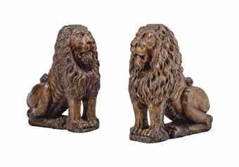 A pair of carved wood lions, probably German and 19th century. From Tanzini Antichità, Milan