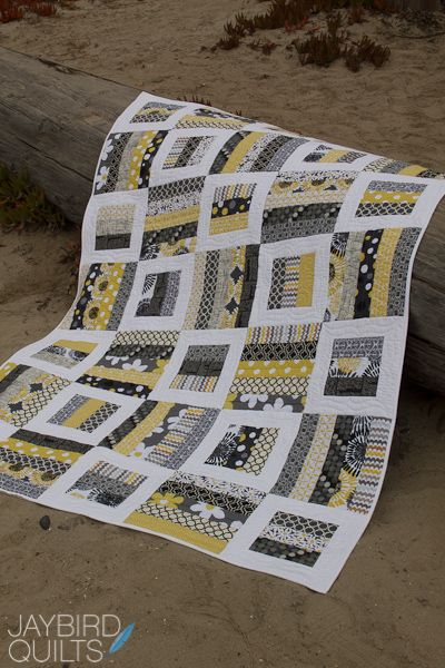 """Radio Way from Jaybird Quilts. Gray, yellow, black & white quilt; uses 2 1/2"""" strips."""