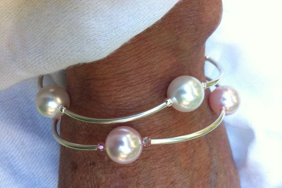 Abby's Blessing Bracelet-  4, 12mm Swarovski pearls, sterling tubes/beads. 5 dollars goes to Abby to help her fight Anaplastic Astrocytoma.