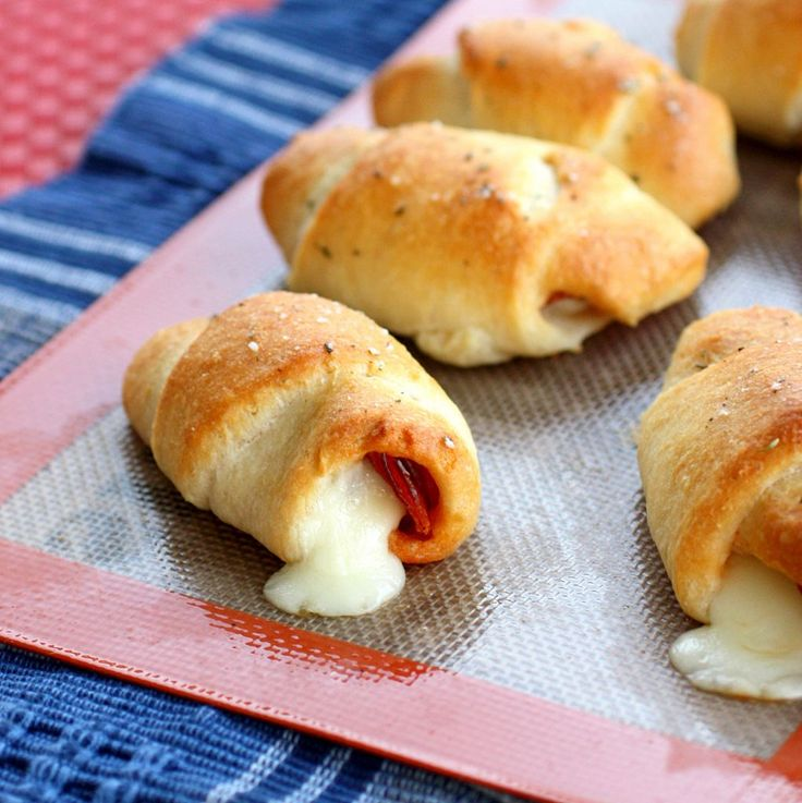These Pepperoni Cheese Stick Roll Ups are great for kids and crowd pleasers. the-girl-who-ate-everything.com