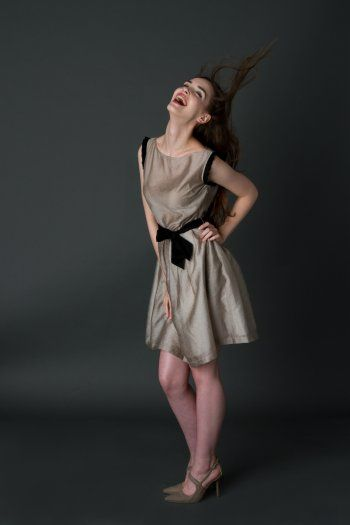 Casual pretty dress with black ruffles applied on shoulders and black girdle