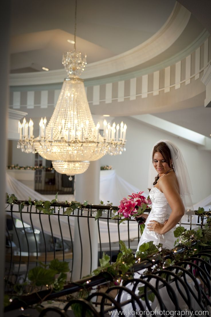 Crystal chandelier grand entrance by the bride down a spectacular staircase to her father who walked her down the aisle. Wedding Planning by MuseEvents.com