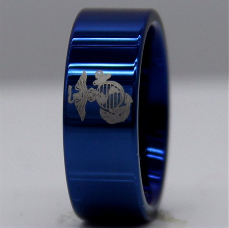 Blue United States Marine Corps Tungsten Ring Made of Tungsten Carbide. A tribute to the men and women of our armed forces. The MILITARY laser design features the emblem of the marine corps. Made from