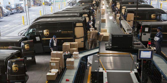 Inside a UPS parcel depot loading up delivery vehicles