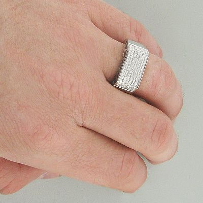 Affordable Mens Diamond Bands! This 14K Gold Diamond Ring weighs approximately 7 grams and showcases 0.64 ctw of sparkling round diamonds. Featuring a classic design and a highly polished gold finish, this men's diamond ring is available in 14K white, yellow and rose gold.