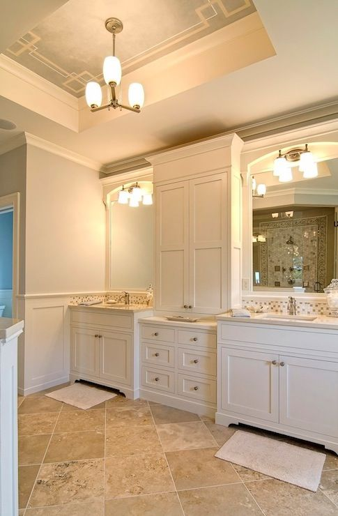 Farinelli Construction: Luxurious bathroom with travertine tiled floor laid diagonally. Creamy white built-in ...