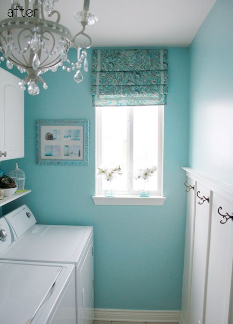 Laundry room:  love the colors and chandelier